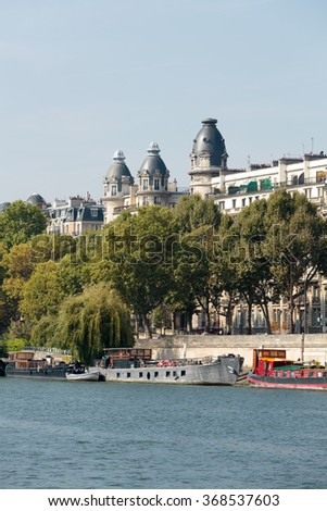 PARIS, FRANCE - SEPTEMBER 9, 2014: Famous quay of Seine in Paris with barges in Summer day. Paris, France
