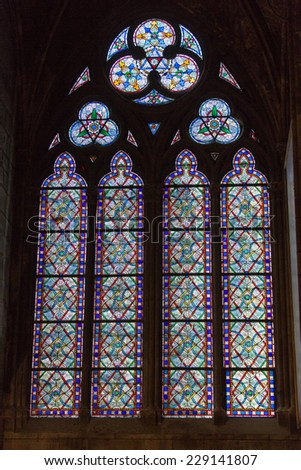 Paris, France - September 9, 2014: Stained glass windows inside the Notre Dame Cathedral, UNESCO World Heritage Site. Paris, France
