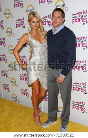 "Paris Hilton, Cy Waits at ""The World According to Paris"" Premiere Party, Roosevelt Hotel, Hollywood, CA 05-17-11"