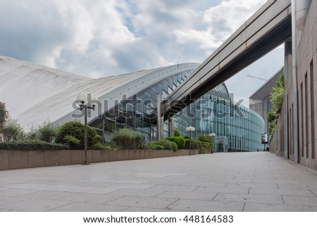 PARIS, LA DEFENSE - MAY 2016. Shopping mall with glass facade. Modern buildings in business district. Concepts of economics, financial, future, job, urban.