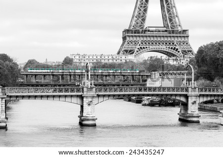 Paris Metro train with Seine River and Eiffel Tower in the background