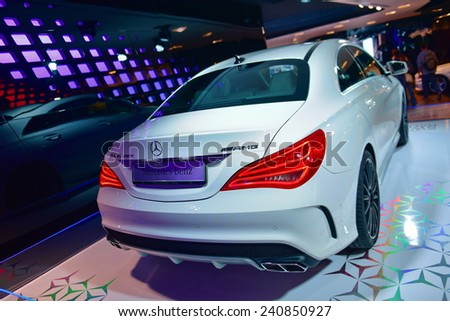 PARIS - SEPTEMBER 24: CLA AMG sports coupe on display at the Mercedes Benz gallery along Champ Elysees, taken on September 24, 2014 in Paris, France