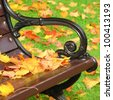 Park bench in autumn - stock photo