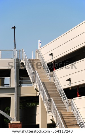 parking lot building with multiple floors and staircase