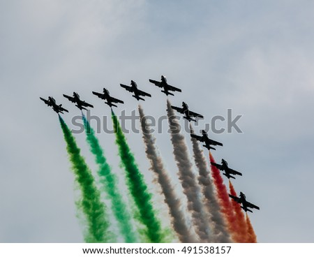 PARMA, ITALY, JUN 21, 2015: Italian acrobatic team Frecce Tricolori (Tricolor arrows) performs a show at the Parma Airshow on June 21, 2015.