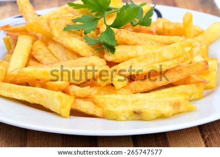 parsley and fried potatoes in dish