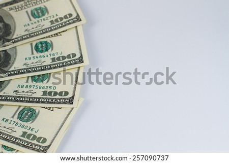 Part of hundred dollar bills on a white background.