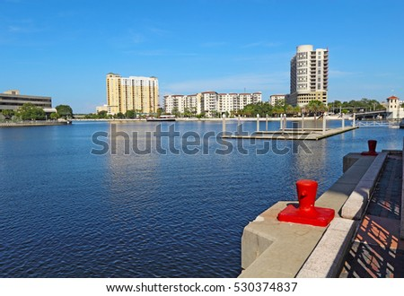 Partial skyline of Tampa, Florida with apartment and condominium buildings at the confluence of Seddon Channel and the Hillsborough River viewed from the Riverwalk near the Convention Center