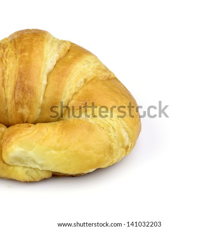 Partial view of croissant on white background