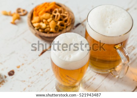 Party food - nbeer and snacks on wood background