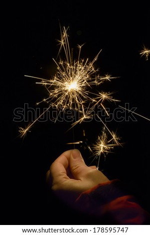 Party sparkler hold in hand