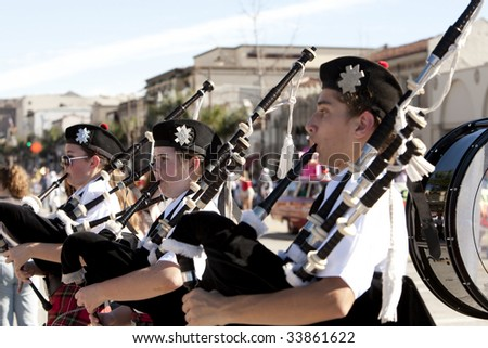 PASADENA, CA - JANUARY 18:  A bag pipe band marches at the Doo Dah Parade on January 18th in Pasadena, CA.  The Doo Dah Parade is a parody of Pasadena's more famous Rose Parade.