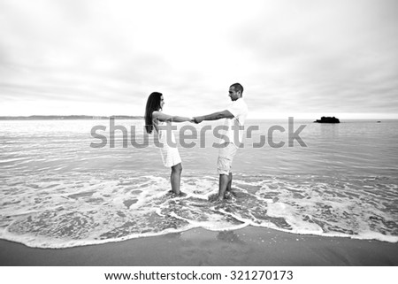 Passionate couple having fun at the beach
