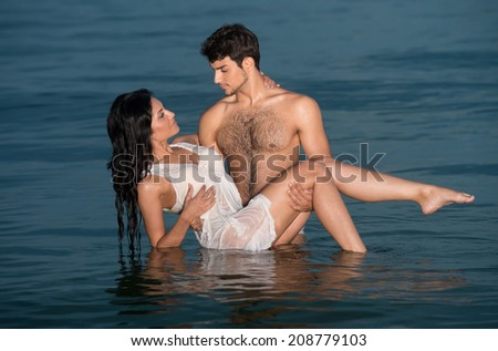 Passionate young couple in water