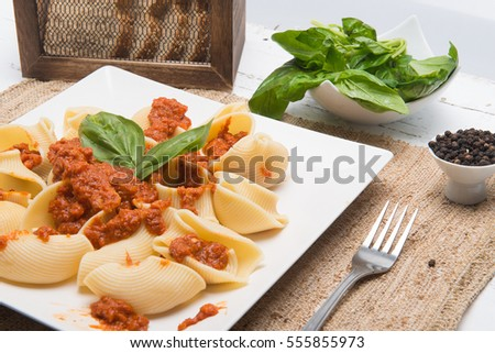 pasta with meat, tomato, sauce and vegetables