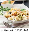 pasta with pesto italian basil sauce and prawns - stock photo
