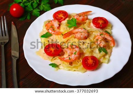 pasta with shrimp, tomatoes, herbs and cream sauce