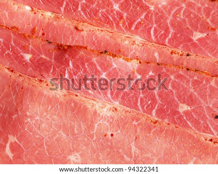 Pastrami slices - closeup; can be used as a background