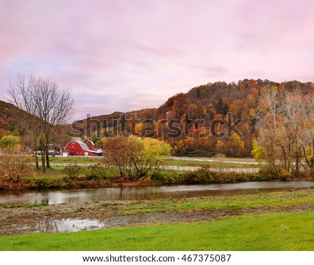 Pasture Lands, A Small River And The Mountains Of Central New York State On A Rainy And Overcast Evening During The Peak Of Autumn, USA