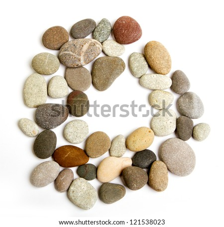 path alphabet of ocean stones frame of colored sea stones on a white background