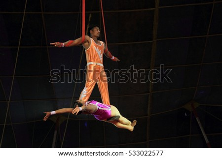 PATHANAMTHITTA, INDIA - JAN 24 : Acrobats of Jumbo Circus performs in their public show held on January 24,2012 in Pathanamthitta, Kerala, India.