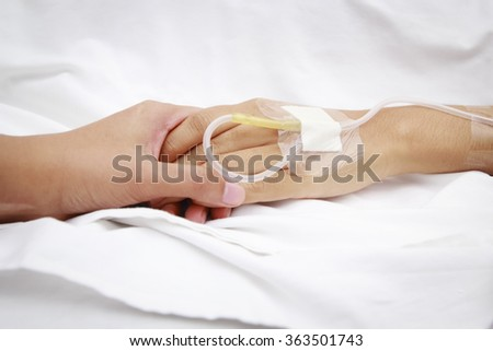 patient in hospital with saline intravenous (iv)