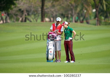 PATTAYA, THAILAND-FEBRUARY 16: Momoko Ueda of Japan discusses her next move with caddy during Round 1 of Honda LPGA 2012 on February 16, 2012 at Siam Country Club Old Course in Pattaya, Thailand