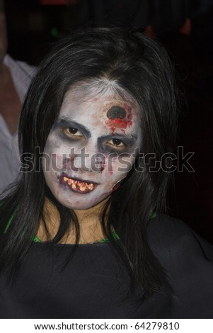 PATTAYA , THAILAND - OCTOBER 31 : Thai girl celebrates Halloween on October 31 2010 in Pattaya, Thailand. Halloween has become popular in Thailand in recent years .