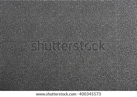 Pattern of dark small brick wall. Background and texture of brick building.