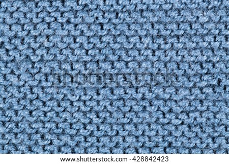 patterned knitted fabric texture closeup photo background.