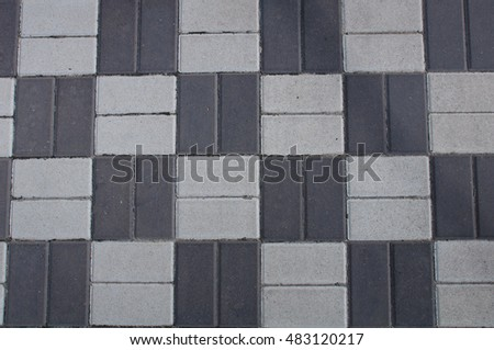 Pavement of black and white. The geometrical pattern. The squares of the same size. The texture of the pavement