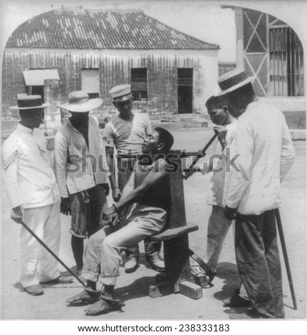 Paying the death penalty for crime, garroting a criminal at Bilibid Prison, Manila, Philippine Islands, 1901.