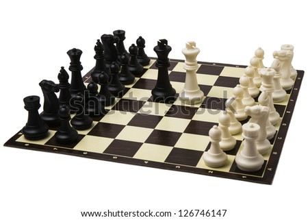 Peace negotiations at the summit level. A ready to play sets of chess and black and white kings in the middle of a chessboard. Peaceful means of conflict resolution.