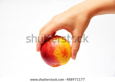 Peach red fresh fruit in woman's hand on white background isolated