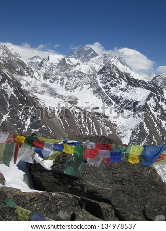 Peak of Mt Everest and prayer flags