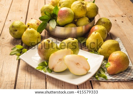 pears in the basket and sliced pear in the plate