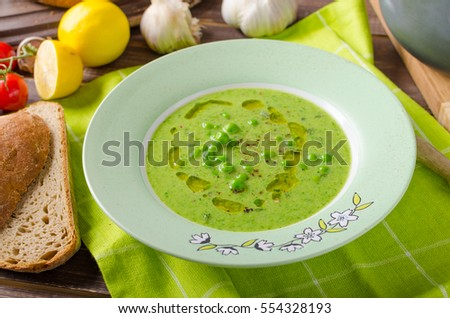 Peas soup with bread, styled photo, place for text, advertisment