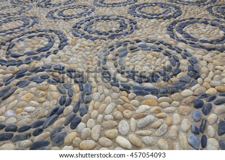 Mosaic pebbles stock photo 588777971 shutterstock for Delicate in texture crossword clue
