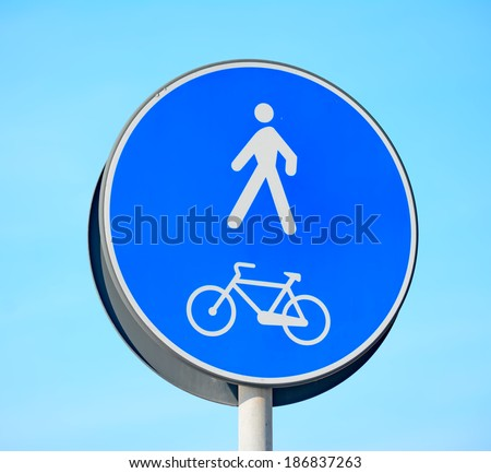 pedestrian and bike lane sign