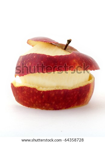 peeled apple with peel wrapped around in studio with white background