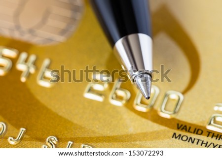 Pen on gold credit card