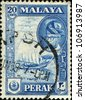 PENANG - CIRCA 1957: A stamp printed in Peneng (Malaya) shows Fishing Craft and inset portrait of Sultan Idris, circa 1957 - stock photo