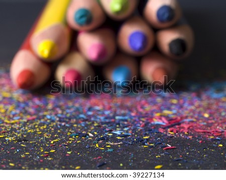 pencil shavings and blurred pencils in background
