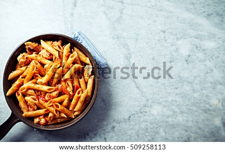 Penne pasta with tomatoes, pepper and chicken breast