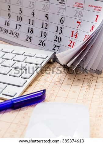 Pens, calendars and computer keyboard