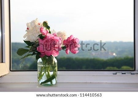Peony bouquet in a glass vase