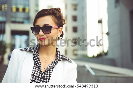 People and success concept. Young business woman in office center.