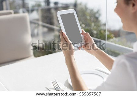People at Restaurant with Tablet