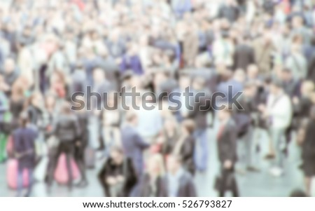 People crowd generic background with an intentional blur effect applied. Humans and location unrecognizable.