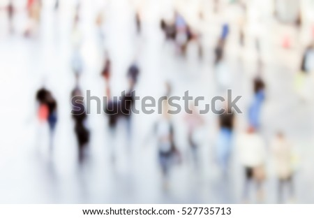 People crowd silhouettes generic background with an intentional blur effect applied. Humans and location unrecognizable.